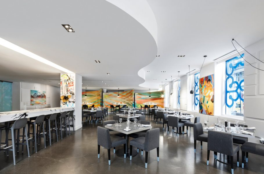 "In E.A.T.'s dining room, direct-on-the-wall graffiti ""frescos"" give way to Jason Cantoro's curving ""colour fields"" embracing dining booths as well many initially blank canvases that are being realized literally while patrons dine listening to music from invited DJs. Photography by Stéphane Brügger"