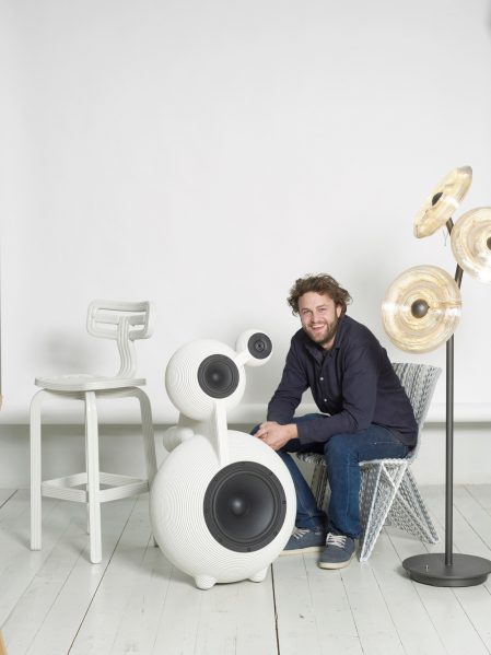 Dirk Vander Kooij sits on Endless Chair, next to Snowmen Speaker, Sunflower Lamp and Chubby Chair. Photo credit: Image Courtesy of Dirk Vander Kooij