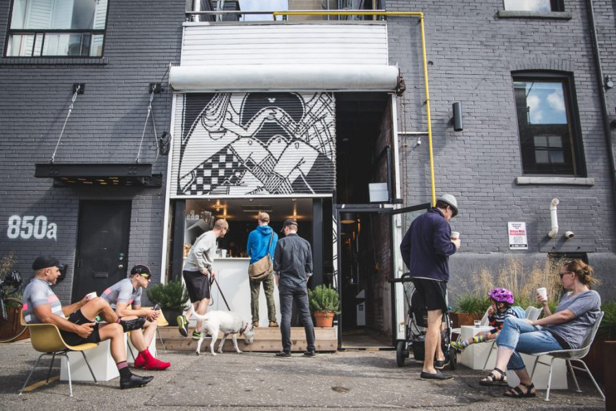 The gentrified head shop-café sits in a upcycled urban alley, its front patio reclaimed from a parking strip. Photo by Roy Gaiot.