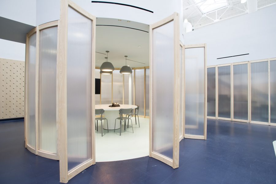 Private spaces like management offices and meeting rooms bisect the cubic volume and are sheathed in low tech translucent polycarbonate sheets framed in ash wood. Nothing touches the outer walls: these are all freestanding structures. Photography by George Pimental Photography