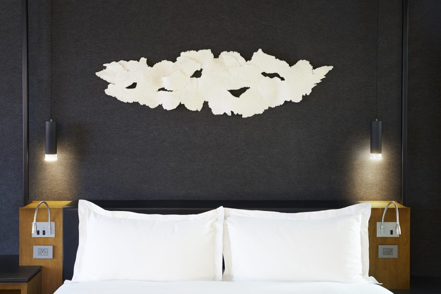 "Ann Bartok and Olena Kassian of BARKAS Productions hand-made all 120 ""Cloud 9"" sculptures, which hang, featherlight, over the beds in Le Germain Hotel Toronto. ""They wanted something elegant, beautiful and uplifting,"" says Kassian. The client agrees that the pieces ""elevate the contemporary atmosphere"" of the newly refurbished hotel."