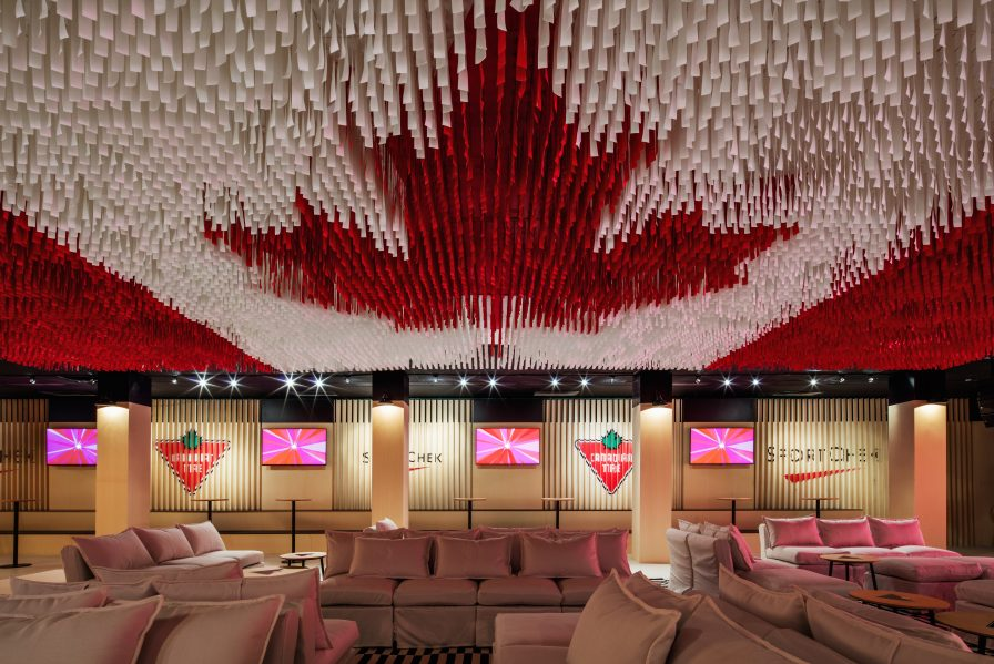 The flag set the tone for Canada House's Celebration Lounge, where broadcasters, athletes and guests gathered to cheer the nation's Olympic successes. Photo by Nelson Kon.